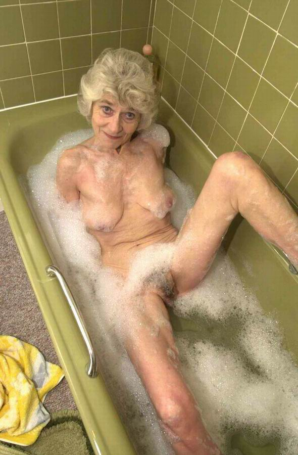 Very old granny taking bath