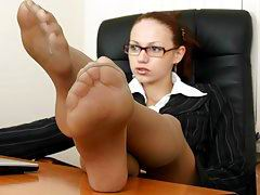 Seductive business-woman humiliating an unworthy manager right in her office.