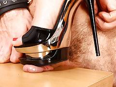 Russian mistress almost squashes yelling slave's dick with her high heels