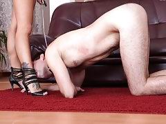 Rough Mistress with tattooed feet makes slave clean her shoes with tongue